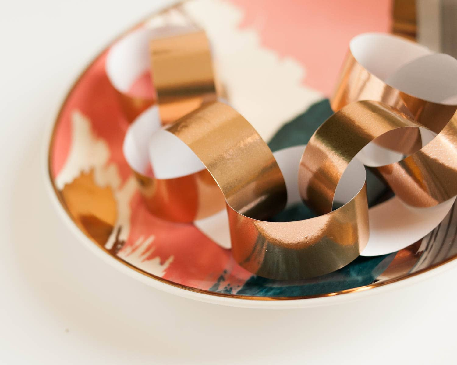 Style your holiday product with paper chains - in this case, a copper gift wrap.